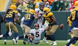 Justin Hollins #52 of the Denver Broncos causes a fumble by Joe Flacco #5 of the Denver Broncos during the second quarter at Lambeau Field on September 22, 2019 in Green Bay, Wisconsin. (Photo by Nuccio DiNuzzo/Getty Images)