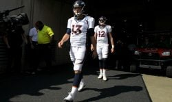 Trevor Siemian #13 of the Denver Broncos and Paxton Lynch #12 of the Denver Broncos walk out to the field prior to the start of the game against the Cincinnati Bengals at Paul Brown Stadium on September 25, 2016 in Cincinnati, Ohio. (Photo by John Grieshop/Getty Images)
