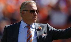 Executive vice president and general manager John Elway of the Denver Broncos is recognized during the pregame ceremony as his jersey number is retired before the game against the Indianapolis Colts at Sports Authority Field Field at Mile High on September 18, 2016 in Denver, Colorado. (Photo by Justin Edmonds/Getty Images)