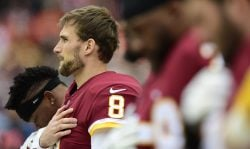 Quarterback Kirk Cousins #8 of the Washington Redskins listens to the National Anthem before a game against the Denver Broncos at FedExField on December 24, 2017 in Landover, Maryland. (Photo by Patrick McDermott/Getty Images)