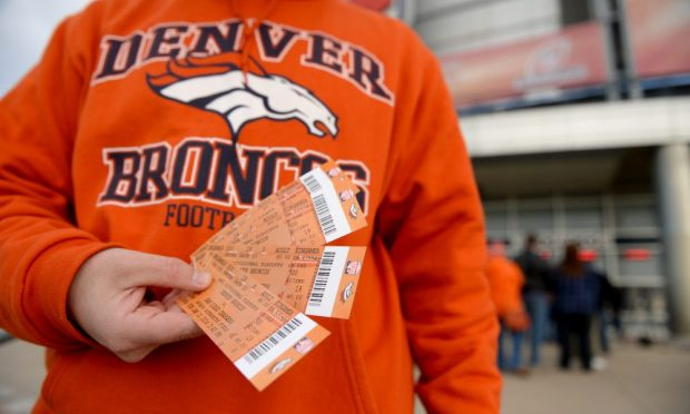 Broncos fan Marc Sleight was able to buy four tickets for the up coming game at Sports Authority Field at Mile High, January, 10 2014. The Denver Broncos will take on the San Diego Chargers in the second round of the NFL playoffs in Denver. (Photo by RJ Sangosti/The Denver Post via Getty Images)