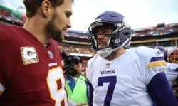 Quarterback Kirk Cousins #8 of the Washington Redskins talks with quarterback Case Keenum #7 of the Minnesota Vikings after the Minnesota Vikings defeated the Washington Redskins 38-30 at FedExField on November 12, 2017 in Landover, Maryland. Keenum signed with Denver Broncos during the 2018 offseason while Cousins joined the Minnesota Vikings. (Photo by Patrick Smith/Getty Images)