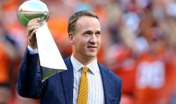 Peyton Manning holds the Lombardi Trophy to celebrate the Denver Broncos in win Super Bowl 50 at Sports Authority Field at Mile High before taking on the Carolina Panthers on September 8, 2016 in Denver, Colorado. (Photo by Justin Edmonds/Getty Images)