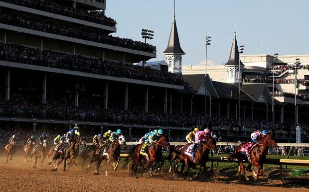 The field races through turn one at the start of the 141st running of the Kentucky Derby at Churchill Downs on May 2, 2015 in Louisville, Kentucky. (Photo by Chris Graythen/Getty Images)