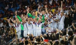 Philipp Lahm of Germany lifts the World Cup trophy with teammates after defeating Argentina 1-0 in extra time during the 2014 FIFA World Cup Brazil Final match between Germany and Argentina at Maracana on July 13, 2014 in Rio de Janeiro. (Photo by Matthias Hangst/Getty Images)