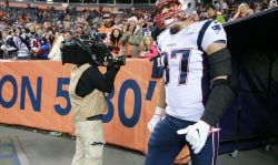 New England Patriots Rob Gronkowski runs onto the field before they play the Denver Broncos at Sports Authority Field at Mile High Stadium in Denver on Nov. 12, 2017. (Photo by Matthew J. Lee/The Boston Globe via Getty Images)