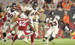 Running back De'Angelo Henderson (33) of the Denver Broncos rushes the football against defensive back A.J. Howard (42) of the Arizona Cardinals during the preseason NFL game at University of Phoenix Stadium on Aug. 30, 2018 in Glendale, Arizona. (Photo by Christian Petersen/Getty Images)