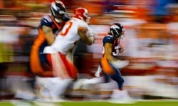 Running back Phillip Lindsay #30 of the Denver Broncos returns a kickoff against the Kansas City Chiefs in a slow shutter exposure at Broncos Stadium at Mile High on October 1, 2018 in Denver, Colorado. (Photo by Justin Edmonds/Getty Images)