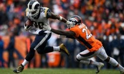 Running back Todd Gurley #30 of the Los Angeles Rams rushes against defensive back Tramaine Brock #22 of the Denver Broncos in the third quarter of a game at Broncos Stadium at Mile High on October 14, 2018 in Denver, Colorado. (Photo by Dustin Bradford/Getty Images)