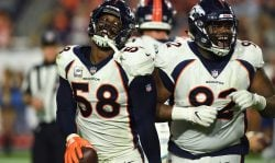Von Miller #58 and Zach Kerr #92 of the Denver Broncos celebrate Millers strip and recovery of a fumble in the second half of their 45-10 win at State Farm Stadium on October 18, 2018 in Glendale, Arizona. (Photo by Joe Amon/The Denver Post via Getty Images)