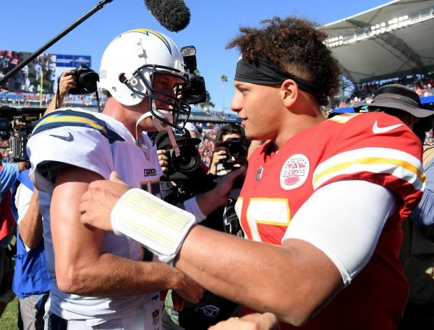 Patrick Mahomes #15 of the Kansas City Chiefs and Philip Rivers #17 of the Los Angeles Chargers shake hands at the end of the game after a 38-28 Chiefs win at StubHub Center on September 9, 2018 in Carson, California. (Photo by Harry How/Getty Images)