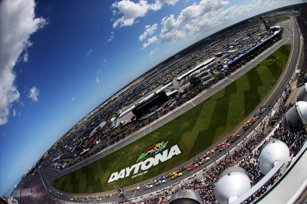 A general view of cars racing during the NASCAR Sprint Cup Series 57th Annual Daytona 500 at Daytona International Speedway on February 22, 2015 in Daytona Beach, Florida. (Photo by Sean Gardner/Getty Images)