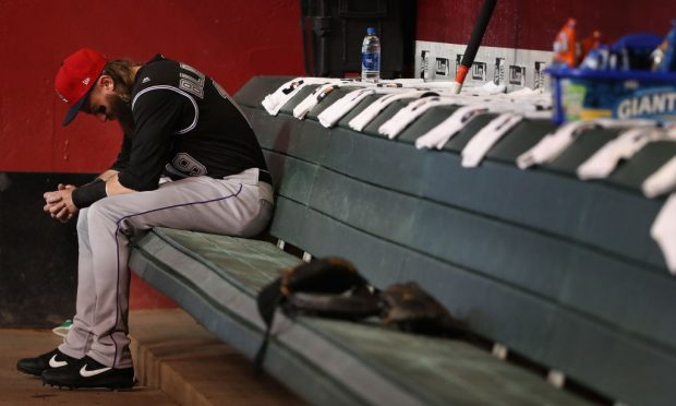 Charlie Blackmon #19 of the Colorado Rockies sits in the dugout before the MLB game against the Arizona Diamondbacks at Chase Field on July 05, 2019 in Phoenix, Arizona. (Photo by Christian Petersen/Getty Images)