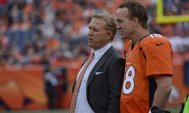 Peyton Manning talks with John Elway at the end of the fourth quarter during the Denver Broncos game against the Oakland Raiders at Sports Authority Field at Mile High on Sunday, September 30, 2012. (Joe Amon, The Denver Post)