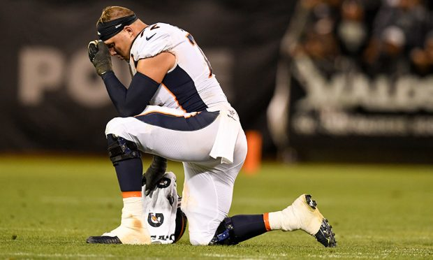 Garett Bolles (72) of the Denver Broncos rests during an injury timeout against the Oakland Raiders during the second half of the Raiders' 24-16 win on Monday, September 9, 2019. (Photo by AAron Ontiveroz/The Denver Post)