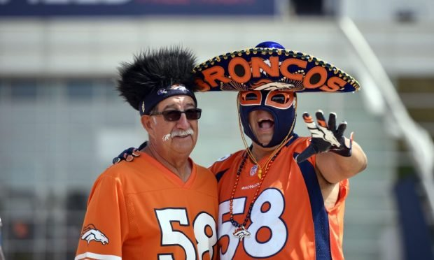 DENVER, CO - SEPTEMBER 15, 2019: Pat Archuleta of Mancos (L) and Gino Villalovas of Arvada (R) pose for a photo prior to the start of the game on on Sunday, September 15th at Empower Field at Mile High. The Denver Broncos hosted the Chicago Bears for the game. Photo by Eric Lutzens/MediaNews Group/The Denver Post via Getty Images