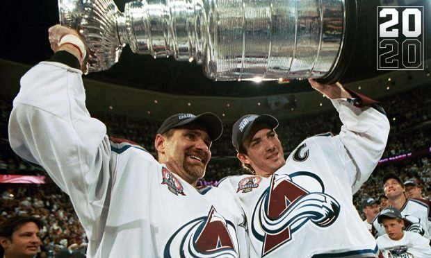 DENVER, COLORADO - JUNE 9: Ray Bourque #77 of the Colorado Avalanche lifts the cup with Joe Sakic #19 after the Colorado Avalanche defeated the New Jersey Devils 3-1 in game seven of the NHL Stanley Cup Finals at Pepsi Center in Denver, Colorado. The Avalanche take the series 4-3. (Photo by B Bennett/Getty Images)