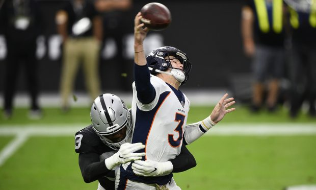 LAS VEGAS, NEVADA - NOVEMBER 15: Defensive tackle Johnathan Hankins #90 of the Las Vegas Raiders hits quarterback Drew Lock #3 of the Denver Broncos during the first half of their game at Allegiant Stadium on November 15, 2020 in Las Vegas, Nevada. (Photo by Chris Unger/Getty Images)