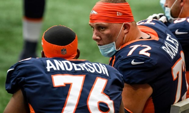 ATLANTA , GA - NOVEMBER 8: Garett Bolles (72) of the Denver Broncos speaks to Calvin Anderson (76) as they play the Atlanta Falcons during the first half at Mercedes-Benz Stadium on Sunday, November 8, 2020. (Photo by AAron Ontiveroz/MediaNews Group/The Denver Post via Getty Images)