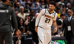 DENVER, CO - MARCH 9: Jamal Murray (27) of the Denver Nuggets laughs despite having his monster dunk on D.J. Wilson (5) of the Milwaukee Bucks being ruled a foul during the third quarter on Monday, March 9, 2020. (Photo by AAron Ontiveroz/MediaNews Group/The Denver Post via Getty Images)