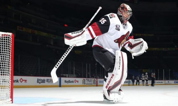 DENVER, COLORADO - MARCH 8: Goaltender Darcy Kuemper #35 of the Arizona Coyotes skates during a break in the action against the Colorado Avalanche at Ball Arena on March 8, 2021 in Denver, Colorado. (Photo by Michael Martin/NHLI via Getty Images)
